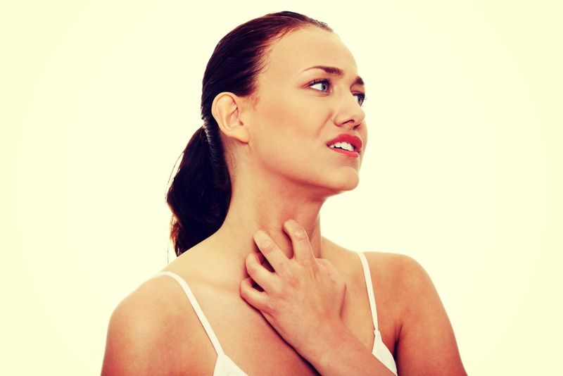 woman scratching her neck skin