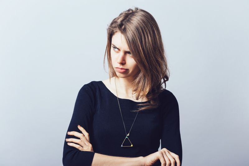 unhappy woman with crossed arms