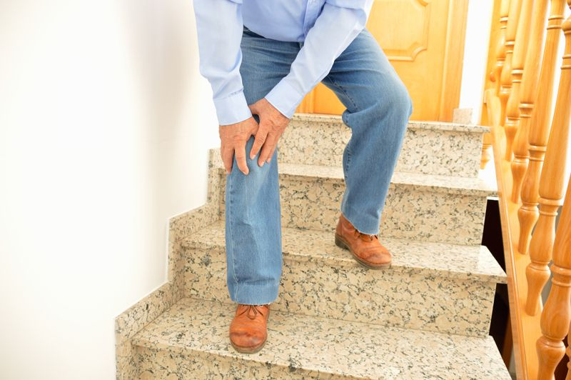 person walking down the stairs in jeans