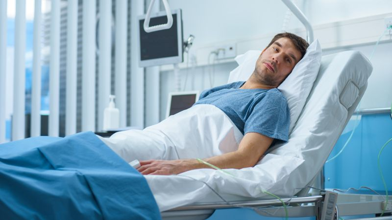 ill man in a hospital bed