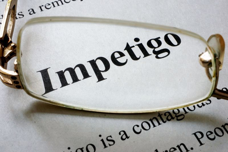 Paper with word Impetigo and glasses