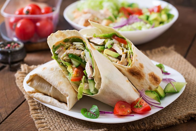 pita wrap with chicken, avocado and tomato chunks