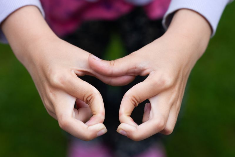 cropped image of child with double-jointed hypermobile fingers