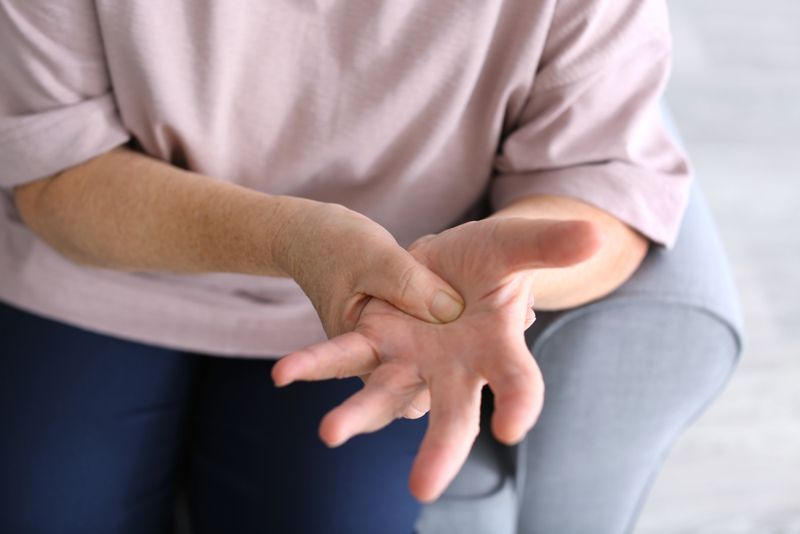 woman with hand pain from osteoarthritis