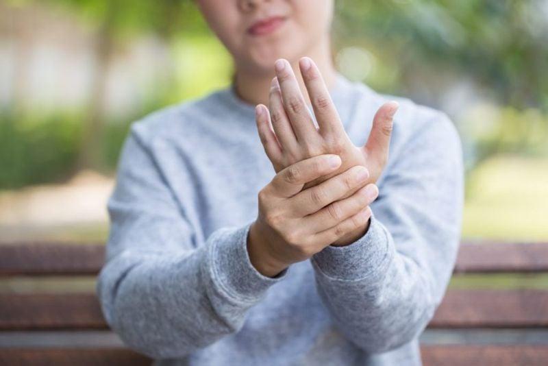 neuropathy holding hand