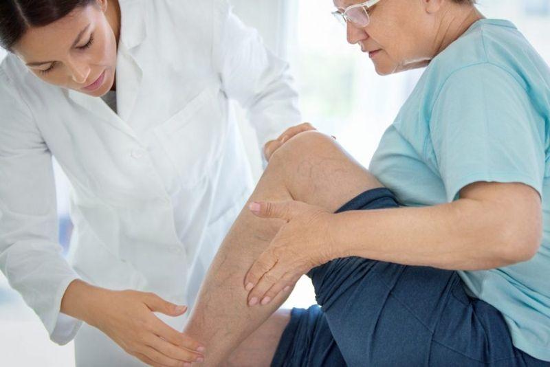 doctor checking leg