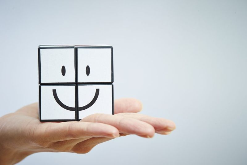 Smiley face puzzle cube