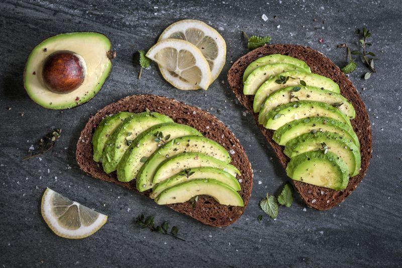 Avocado sandwich on dark rye bread made with fresh sliced avocados from above