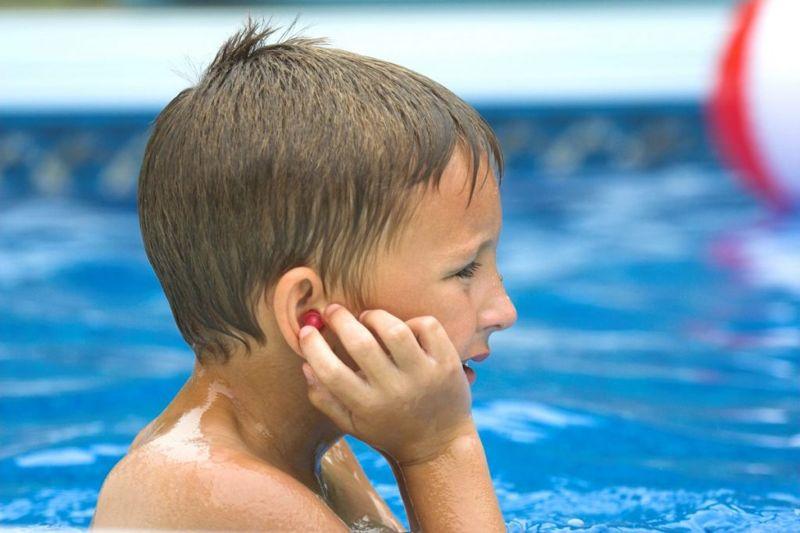 swimmer touching ear