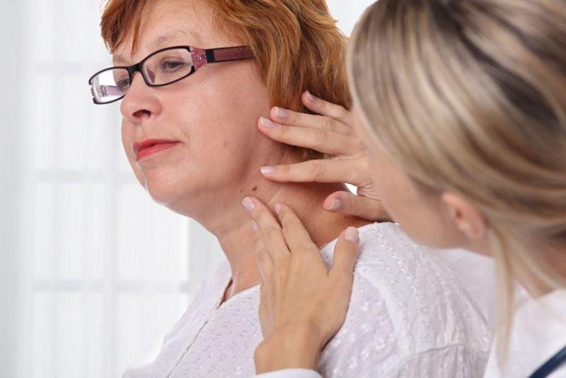 older adult dermatologist patient