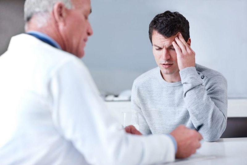 male doctor migraine