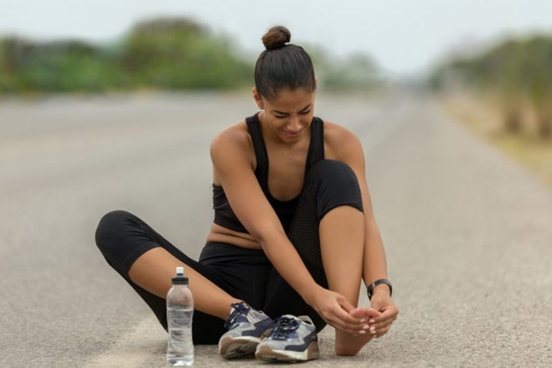 woman runner foot pain