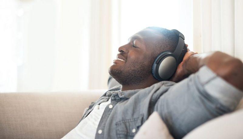 man lying headphones