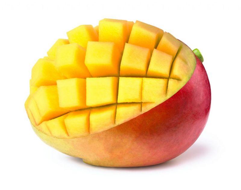 cutting fruit mangoes