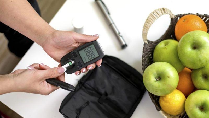 woman measuring blood sugar