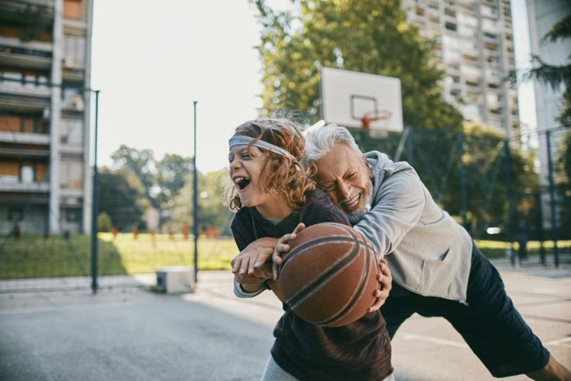 healthy senior playing with child