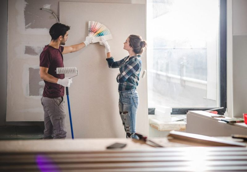 Couple choosing new paint