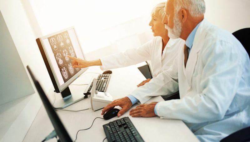 researchers scanning brain