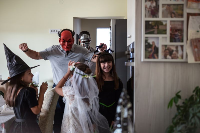 Whole family put their Halloween costumes and celebrating at home