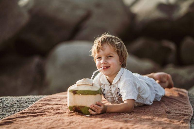 boy drinking fresh coconut water