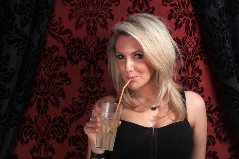 woman drinking club soda