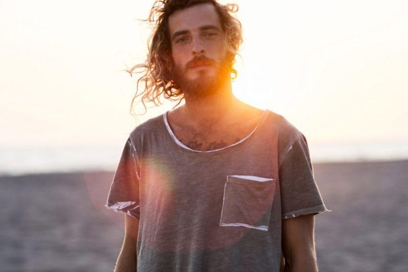 long hair bearded hippie look.