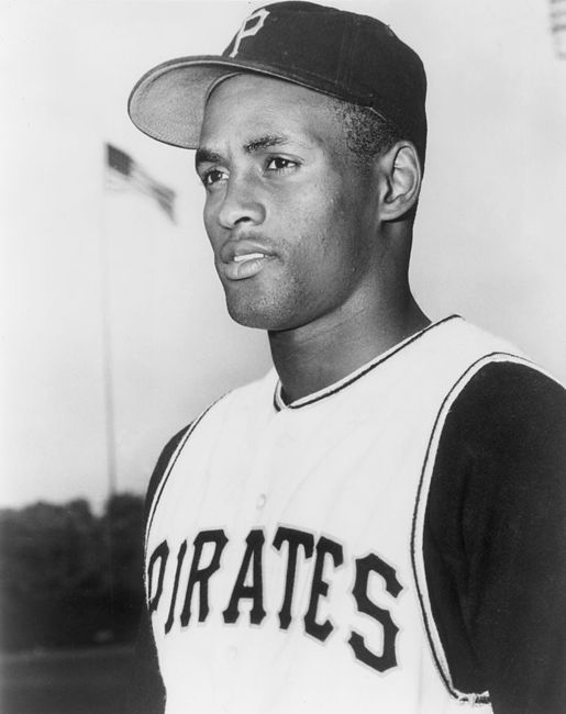 Headshot of Puerto Rican baseball player Roberto Clemente of the Pittsburgh Pirates at a baseball field in uniform.