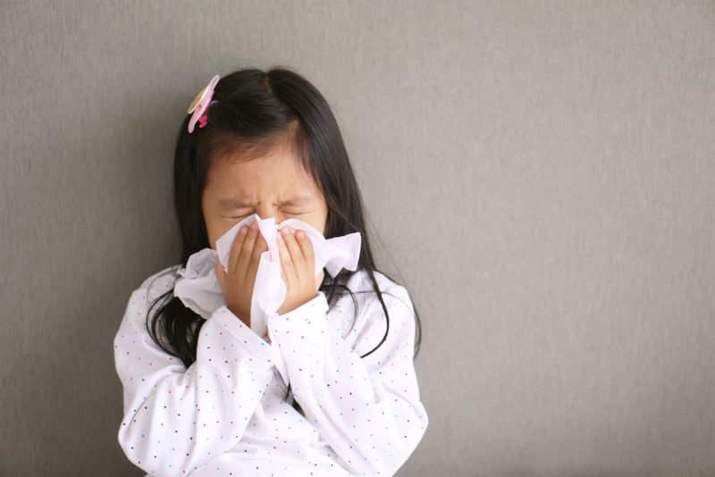 little girl having a sneeze