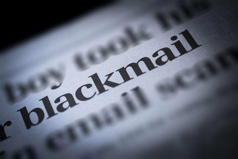 Blackmail written newspaper, shallow dof, real newspaper
