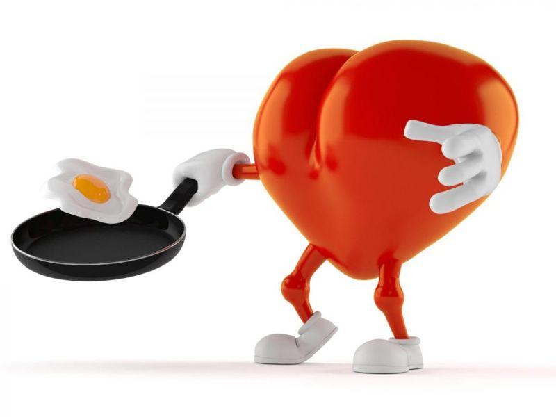 heart character frying eggs