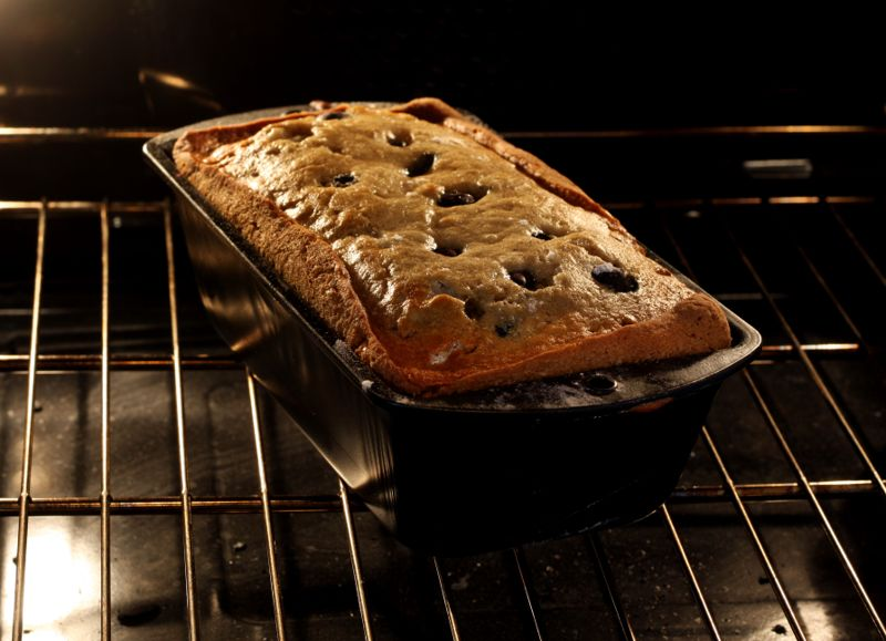 A pan of blueberry-banana bread baking in an oven. All images in this series...