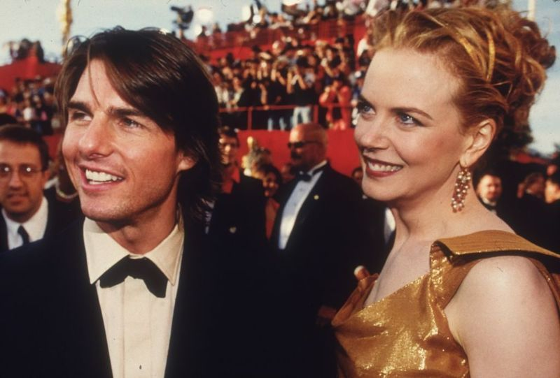 Headshot of married actors Tom Cruise and Nicole Kidman as they arrive at the Academy Awards ceremony, Shrine Auditorium, Los Angeles, California. Cruise was nominated for Best Supporting Actor for his role in director Paul Thomas Anderson's film, 'Magnolia.'