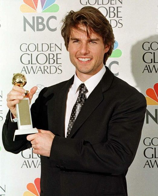 """Actor Tom Cruise holds his award for Best Actor in a Motion Picture Comedy for his role in """"Jerry Maguire"""" 19 January at the 54th Annual Golden Globe Awards in Beverly Hills, California."""