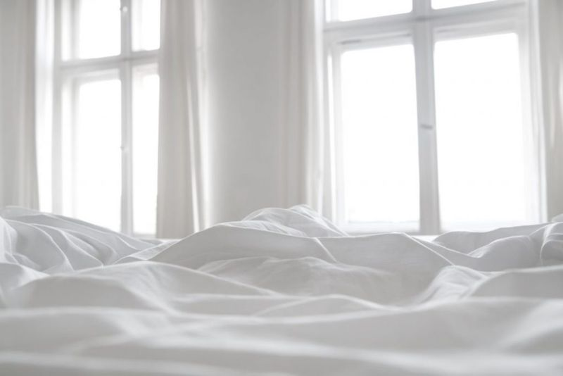White linen bed sheets