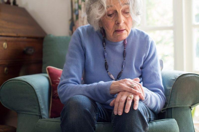 woman parkinsons disease hands
