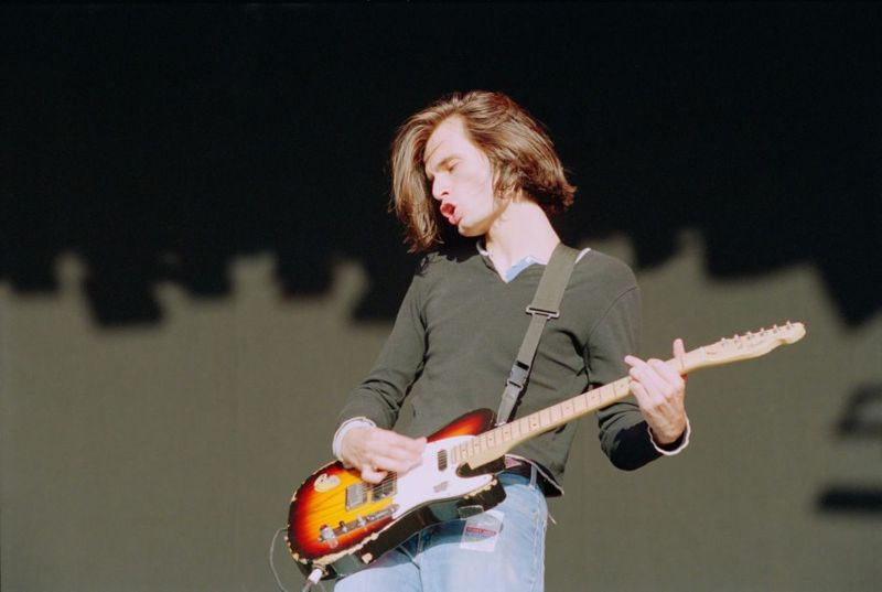 English musician Jonny Greenwood of rock band Radiohead performs live on stage playing a Fender Telecaster Plus guitar at the 1994 Reading Festival in England on 27th August 1994.