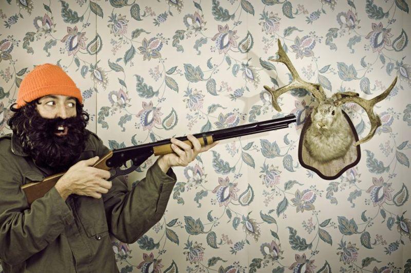 Funny hunter with jackalope trophy