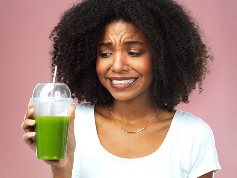 woman fresh juice worried