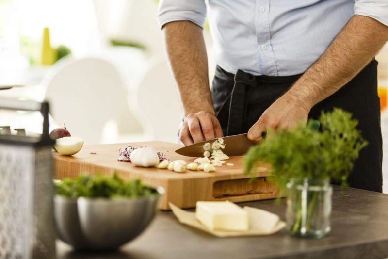 chopping garlic cooking