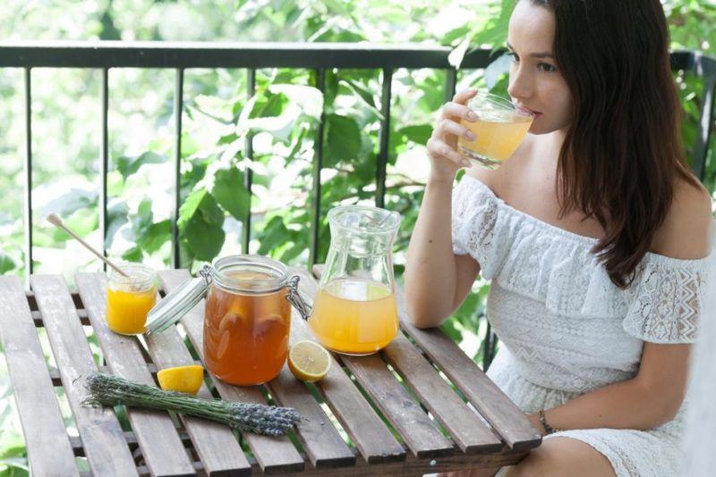 woman drinking kombucha