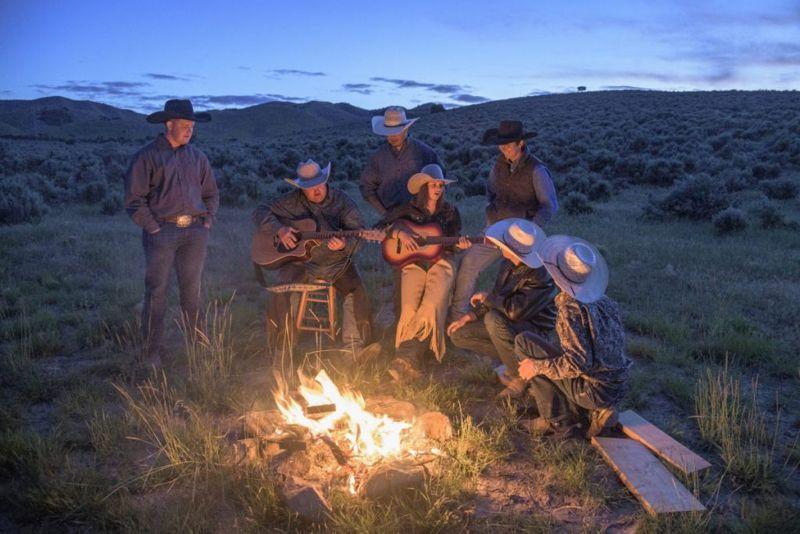 Cowboys gathering around campfire