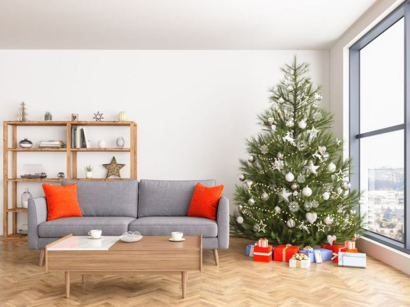 Christmas tree with presents and sofa