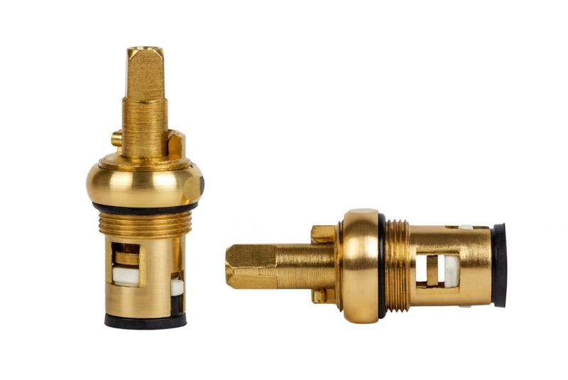 Brass faucet parts cartridge for water valve isolated on white background