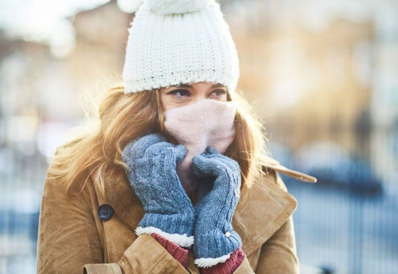 Shot of an attractive young woman enjoying being out in the snow
