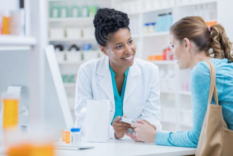 woman speaking to her pharmacist