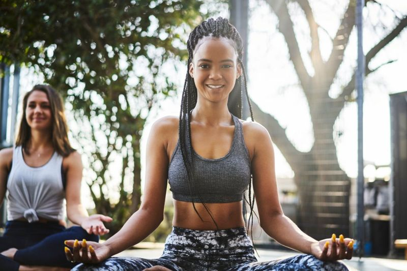 Young woman practicing lotus position