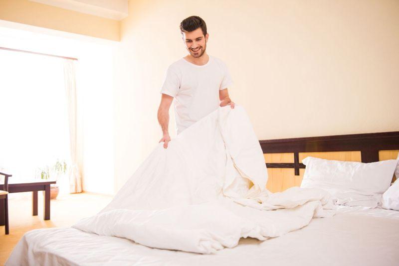 man folding a sheet