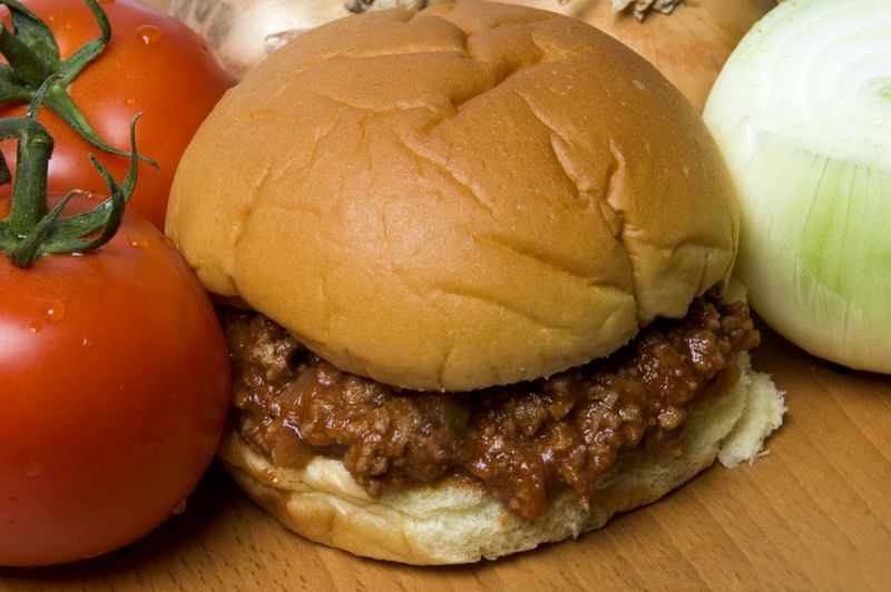 sloppy joe sandwich with tomatoes and onions