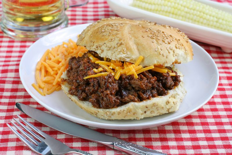 Sloppy Joe Sandwich, close up, with Cheddar Cheese.