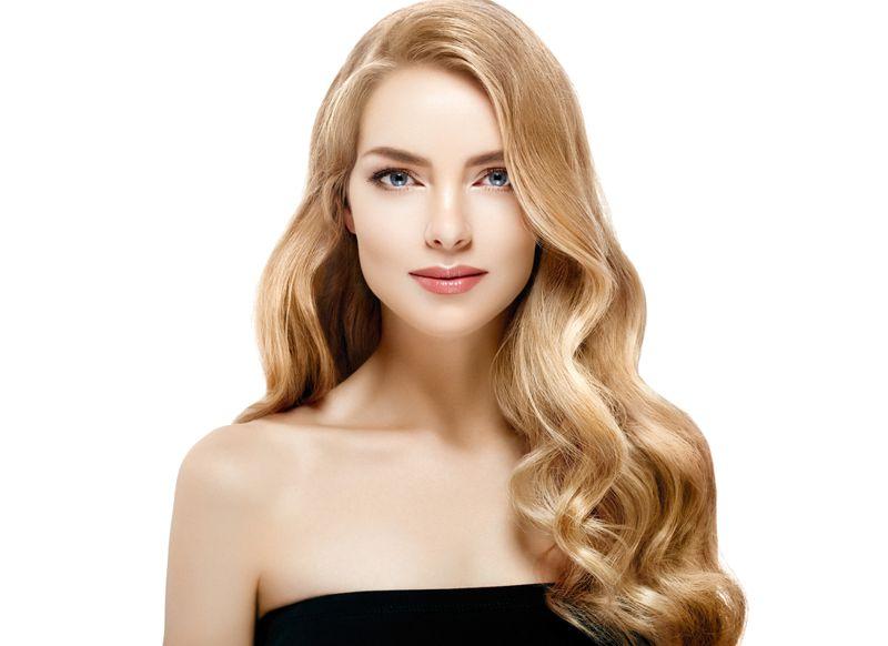 Blonde model looking camera smiling nude makeup